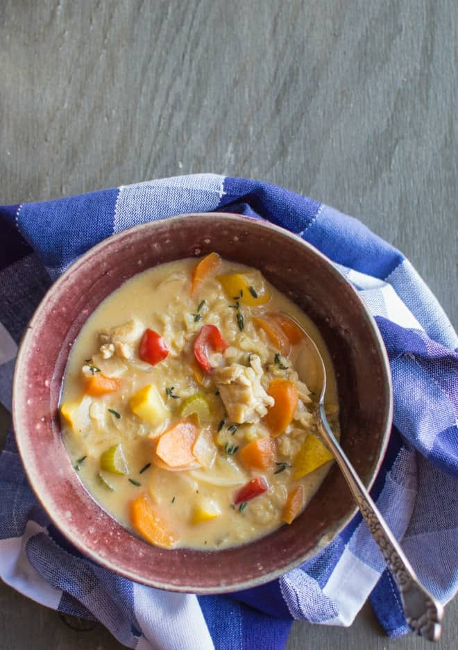 chicken and rice soup filled with vegetables and thyme. Ease into soup ...