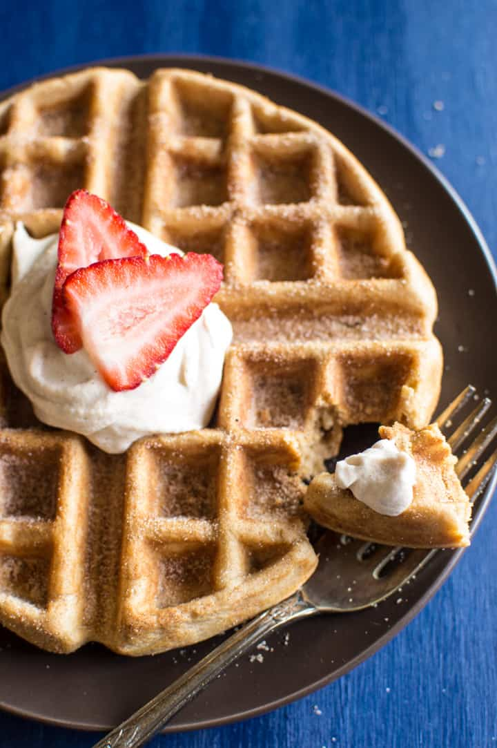 Churro Waffles with Cayenne Whipped Cream - delicious waffles sprinkled generously with cinnamon and sugar, and topped with a homemade cayenne cinnamon whipped cream. Perfect for brunch! | healthynibblesandbits.com