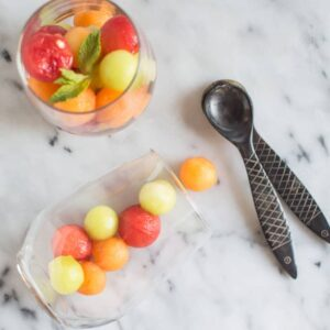 NATURALLY-SWEETENED Vodka Infused Melon Balls - this refreshing dessert is infused with pear juice and coconut sugar. Perfect for a picnic or BBQ!