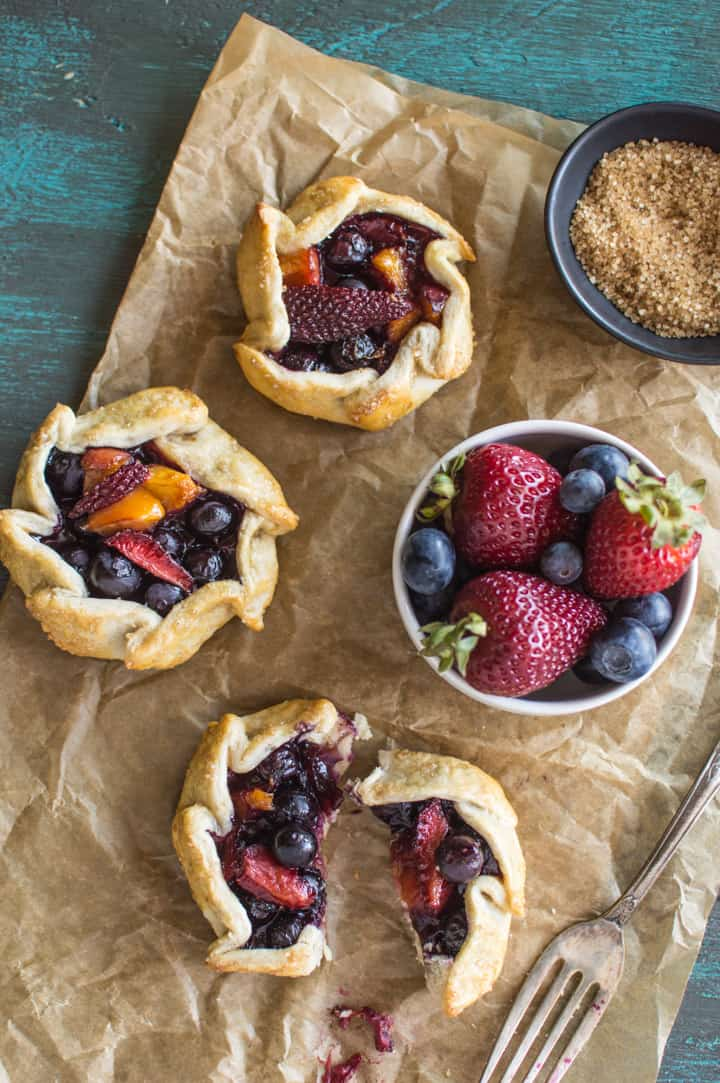 Mini Berry and Peach Galettes - the perfect summer treat! | healthynibblesandbist.com