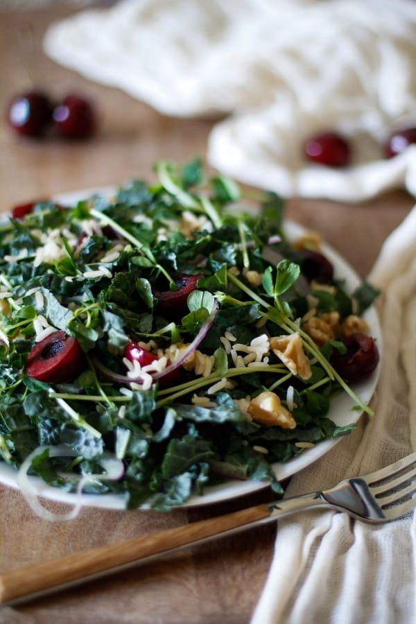 Cherry and Peashoot Kale Salad with Date Balsamic Vinaigrette | The Roasted Root