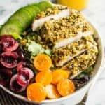 Pistachio Crusted Chicken Salad with Carrot Ginger Dressing - this gluten-free and paleo salad is perfect for weeknights. Ready in 30 minutes!   healthynibblesandbits.com