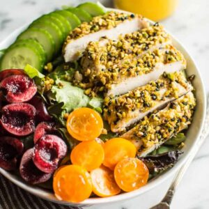 Pistachio Crusted Chicken Salad with Carrot Ginger Dressing - this gluten-free and paleo salad is perfect for weeknights. Ready in 30 minutes! | healthynibblesandbits.com