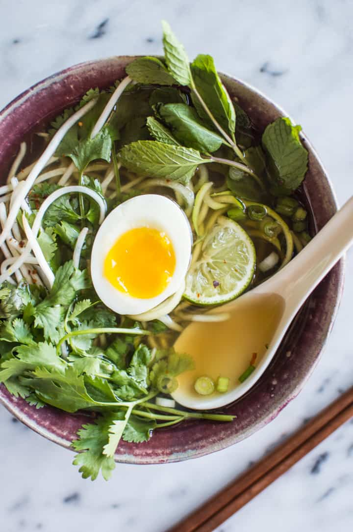 This healthy vegetarian pho with zucchini noodles is easy to make. The broth is infused with onions, ginger, star anise, cinnamon, cloves, and garlic.