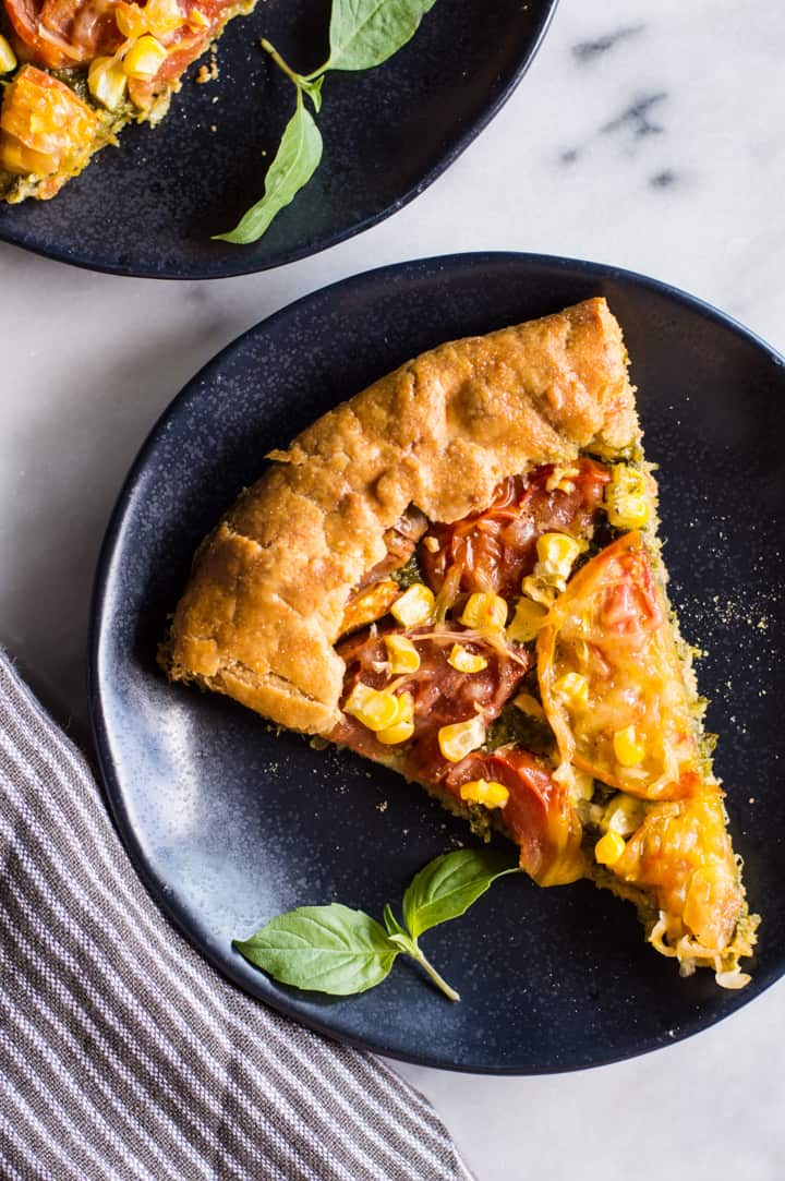 Gluten-Free Heirloom Tomato Galette with Kale Pesto - a delicious savory galette with a flaky gluten-free crust! | healthynibblesandbits.com