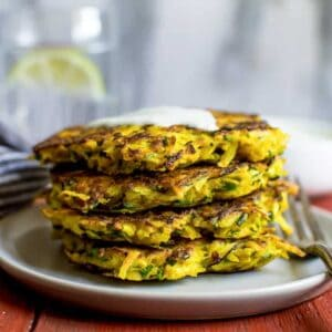 8-Ingredient Turmeric Zucchini and Potato Fritters - easy gluten-free sides that are perfect for any meal! | healthynibblesandbits.com