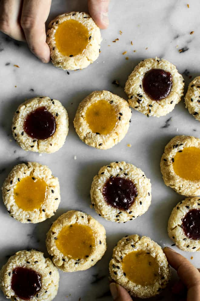 Easy Gluten-Free Coconut Thumbprint Cookies that are made with less than 10 ingredients! by Lisa Lin of healthynibblesandbits.com