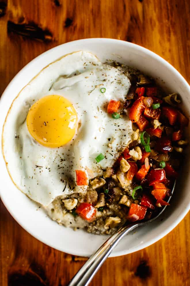 Savory Oatmeal with Cheddar and Fried Egg - perfect breakfast bowl ready in 10 minutes! by Lisa Lin of healthynibblesandbits.com