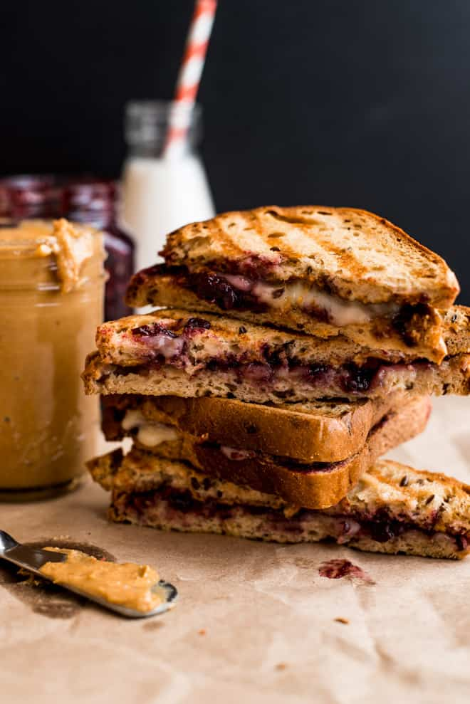 Grilled Peanut Butter and Jelly Sandwich with Brie Cheese - this is the ULTIMATE comfort food! Ready with just 5 ingredients! by Lisa Lin of healthynibblesandbits.com
