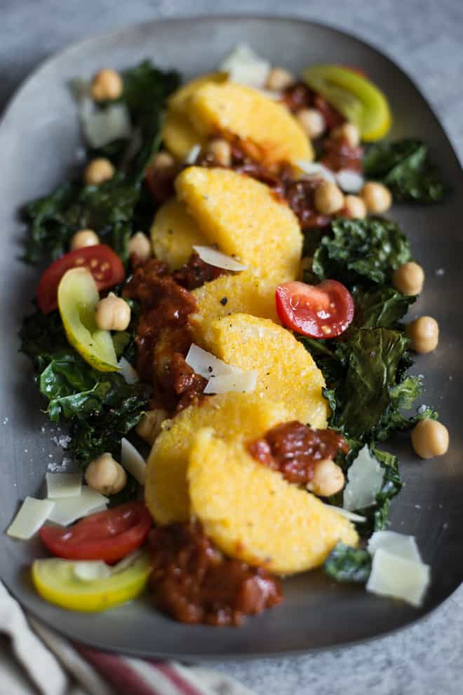Pan Fried Polenta with Roasted Kale and Chickpeas - topped with tomatoes and parmesan cheese, this is the perfect light gluten-free dinner! Made with just 6 ingredients! by @healthynibs