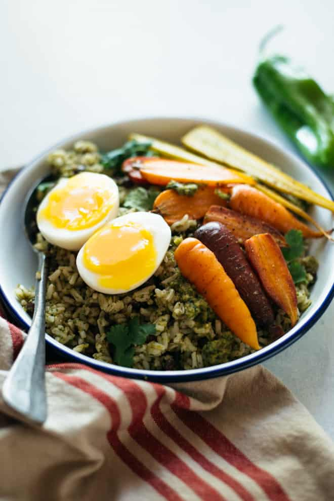 Rice Bowl with Green Chile Sauce, Roasted Carrots & Eggs - a hearty vegetarian fall meal by @healthynibs