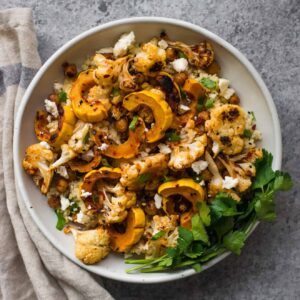 This Harissa Roasted Cauliflower with Delicata Squash & Chickpeas is a healthy, gluten-free weeknight dinner!