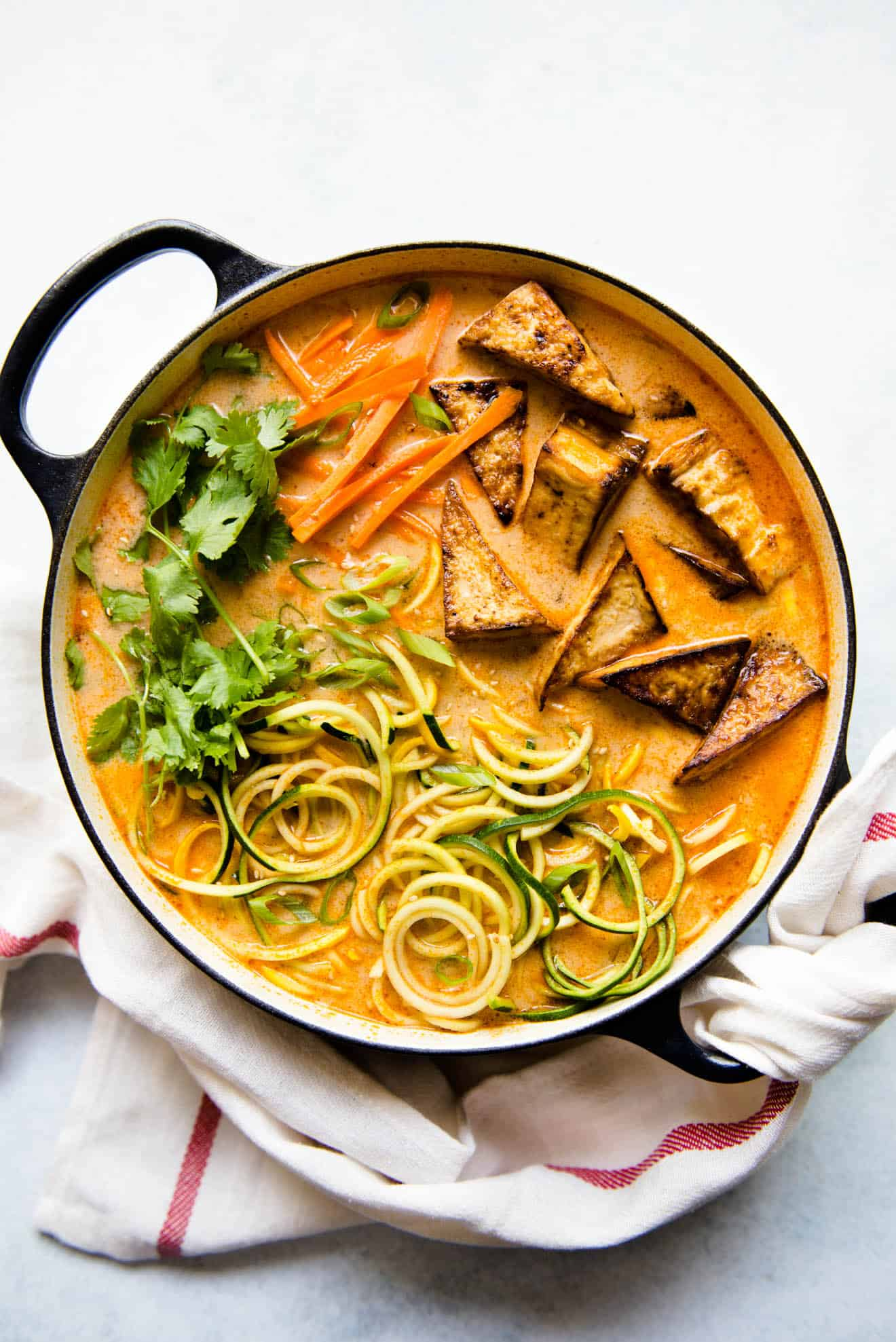 Zucchini Noodles Tomato Coconut Broth and Pan-Seared Tofu - a delicious vegan meal for weeknights