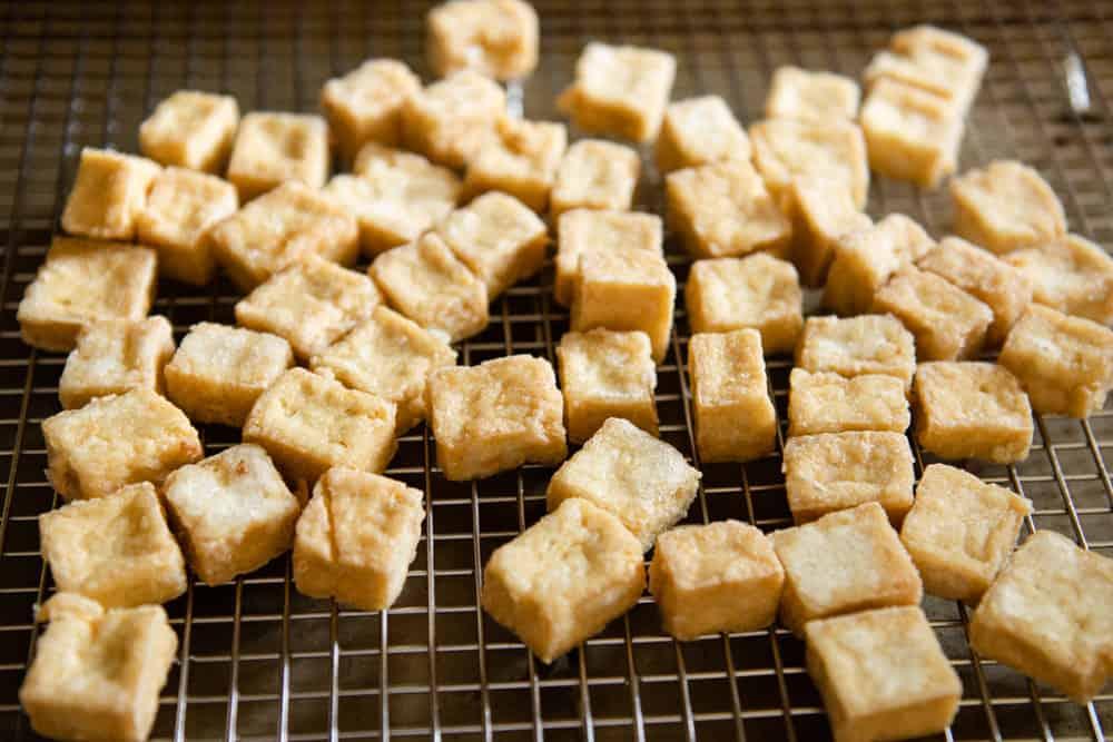 Fried tofu on cooling rack