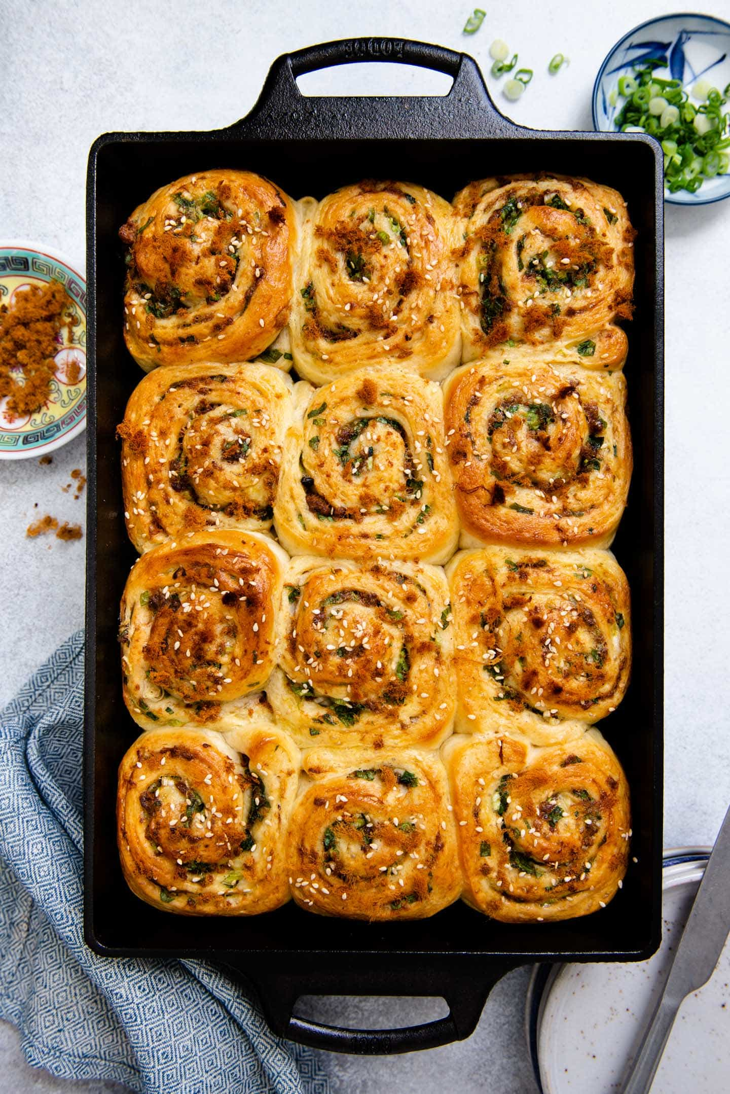 Photo of scallion and pork floss rolls in a cast iron casserole pan