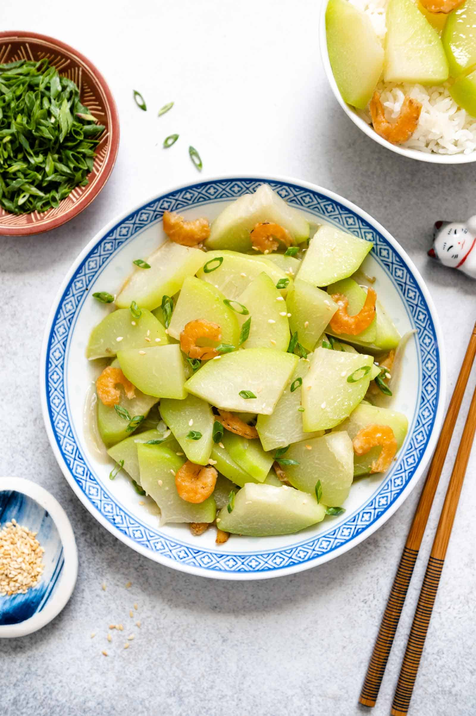 Chinese Stir Fried Chayote in a bowl with garnish