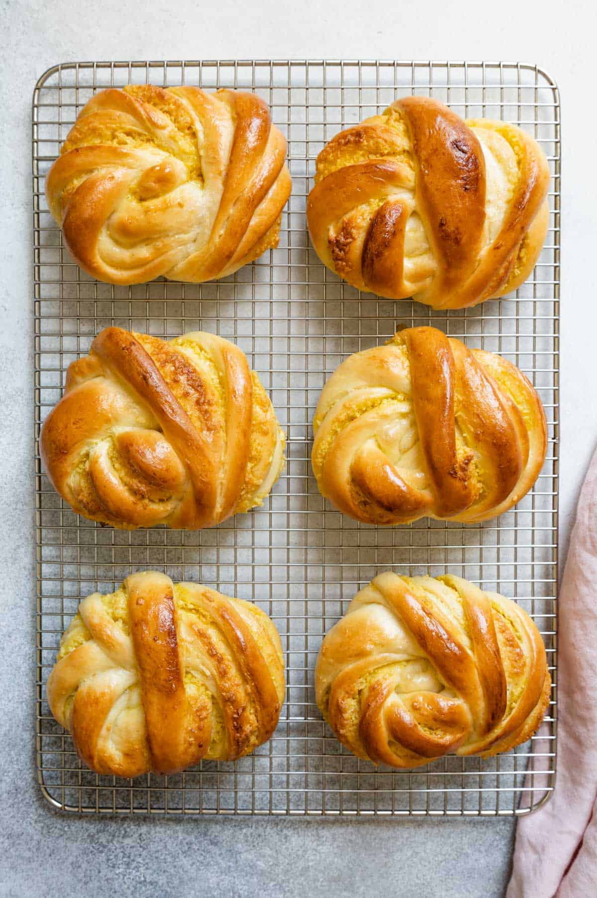 Coconut buns on cooling rack