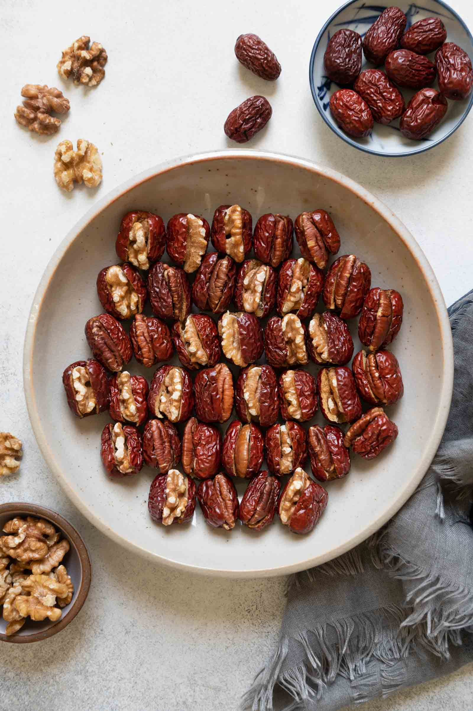 Stuffed Red Dates with Walnuts and Pecans in a plate